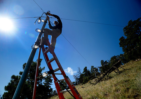 Craig Reynolds, owner of Lord and Reynolds Electrical, works on repairing the damage to the Flagstaff Star in Boulder, Colorado September 28, 2012. Reynolds has volunteered his time for a decade to keep the Flagstaff Star lit. DAILY CAMERA/ MARK LEFFINGWELL
