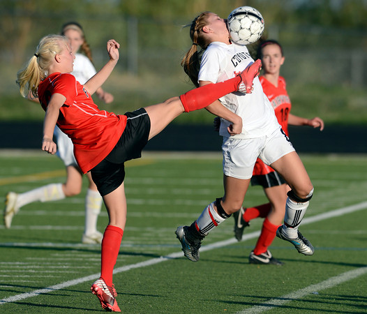 Monarch's Cassie Owens (right) takes a high kicked ball to the face from Fairview's Lauren White (left) during their soccer game in Louisville, Colorado May 1, 2012. CAMERA/MARK LEFFINGWELL