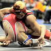 Centaurus' Andre Aragon (bottom) fights his way loose against Heritage's Kris Thomsen (top) during the first round of the 2012 State Wrestling Tournament in Denver, Colorado February 17, 2012. CAMERA/MARK LEFFINGWELL