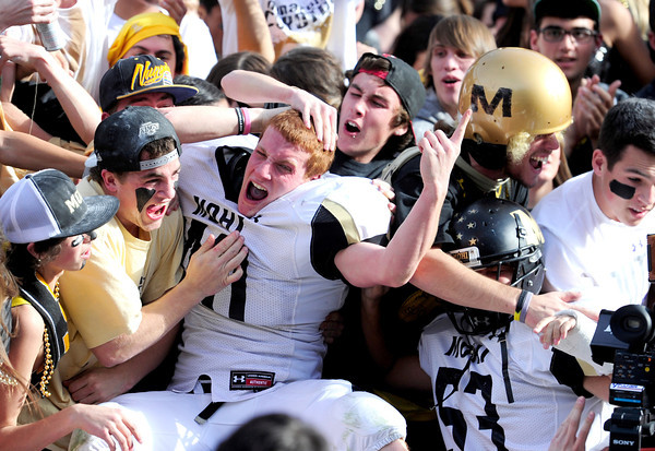 Monarch's Dylan Glazer is mobbed by classmates in the stands after beathing Denver South in the 4A State Football Championship football game in Denver, Colorado December 1, 2012. BOULDER DAILY CAMERA/ Mark Leffingwell......