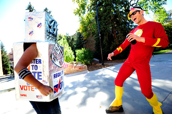 REGISTER.jpg The Vote-Bot played by Marites Velasquez has a dance-off with Flash Gordon played by Brook Stableford as they both work to register voters on the University of Colorado Boulder Campus on Monday October 8, 2012. <br /> The Vote-Bot was representing CoPIRG New Voters Project and Flash Gordon was dancing for New Era Colorado.<br /> Photo by Paul Aiken / The Daily Camera