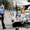 """BUGWRECK.JPG BUGWRECK.jpg Boulder Police Accident Investigator Jeremy Hanel looks over the scene of a head-on collision at the intersection of Kalmia Avenue and 28th Street in Boulder on Tuesday morning. For a video from the scene go to  <a href=""""http://www.dailycamera.com"""">http://www.dailycamera.com</a><br /> Photo by Paul Aiken  Jan 3, 2012"""