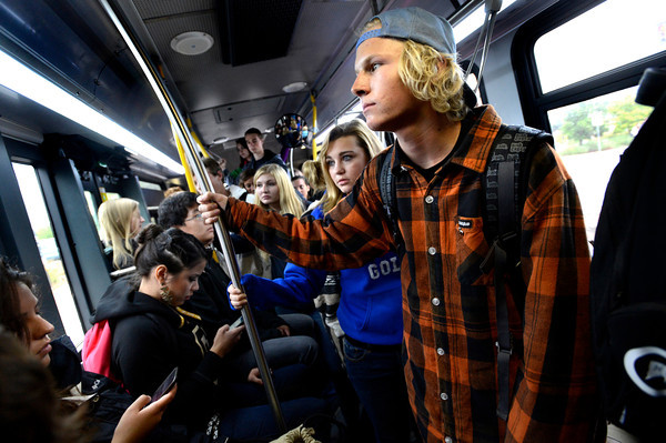 BUSFRESH.jpg Adlar Thomas, a freshman from Oregon riding standing on the crowded shuttle bus to the Williams Village dorm complex from the University of Colorado Boulder Campus on a rainy Wednesday afternoon. With Thomas is Amanda Tadla a freshman from Centennial Colorado.<br /> Photo by Paul Aiken / The Camera