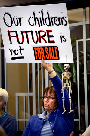 FRACKING.jpg Karen Conduff holds up a sign during the Boulder County Planning Commission's session and public hearing on proposed revisions to the county Land Use Code's rules and regulations about oil and gas exploration at the Boulder County Courthouse on Monday afternoon September 24, 2012.<br /> Photo by Paul Aiken