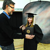 GRADFAIR.jpg Katelyn Murry, a University of Colorado Senior, gets set up for the perfect smile by photographer Kevin McIlwaine, of Classic Photography, at the Grad Fair 2012 at the University Memorial Center on Tuesday March 20, 2012. <br /> Photo by Paul Aiken / The Camera