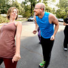 "Dancewalk365.JPG Lindsay Sworski, jokes with Roger Wolsey during a dance walking session through downtown Boulder  on Wednesday September 19, 2012. <br /> For more photos of the Dancewalk go to  <a href=""http://www.daiycamera.com"">http://www.daiycamera.com</a><br /> Photo by Paul Aiken"