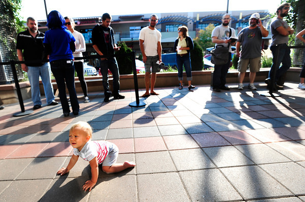 IPHONE.jpg Kemba Click, 11 months, crawls past the line outside the Apple store in the Twenty Ninth Street Mall on Friday morning as the new iPhone 5 went on sale. Click's dad was there to buy a phone.<br /> Photo by Paul Aiken / The Daily Camera / September 21, 21012
