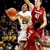 CUVSWASHSTATE21.JPG University of Colorado's #25 Spencer Dinwiddie shoots over Washington State's #2 Mike Ladd while #40 Charlie Enquist attempts a block during their game at the Coors Events Center on the University of Colorado Boulder, Colo. Campus on Saturday January 7, 2012<br /> Photo by Paul Aiken  Jan 7, 2012