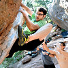 GOLFCLUB.jpg Kyle Black looks for a foot placement on Golf Club on Flagstaff Mountain on Monday afternoon. Black successfully solved the problem on the rock as his climbing partners Joshua Smith, right and Patrick Knight offer protection from below.<br /> Photo by Paul Aiken  /  June 11, 2012