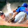 """WARRIORS032.JPG The Warriors David Shald (6) dives back safely to third base as <br /> Brandon Rix tries to apply the tag in the game against Canon City played at Centaurus High School in Lafayette on July 24, 2012.<br /> For more photos go to  <a href=""""http://www.bocopreps.com"""">http://www.bocopreps.com</a>.<br /> Photo by Paul Aiken / The Camera"""