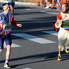 201227BOLDER.JPG Chris Davis, dressed in his regular Bolder Boulder religious dress takes a look over a more patriotically dressed Grant Caswell as they take a brief lead at the start of the Citizen's Race during the  2012 Bolder Boulder.<br /> Photo by Paul Aiken / The Camera