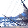 POLES3.jpg A Power Company employee surveys the scene of downed power poles on 19th Street in Boulder on Wednesday afternoon. <br /> Photo by Paul Aiken