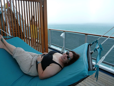 Ronda relaxes just before the rain arrives abort the Carnival Legend in Belize.