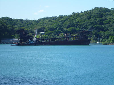 An partially sunken rusty ship in Mahogany Bay, Roatan, Honduras.