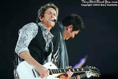 Joe Don Rooney and Jay DeMarcus of Rascal Flatts perform on January 27, 2012 during their 'Thaw Out' tour at the Dunkin Donuts Center in Providence, RI.