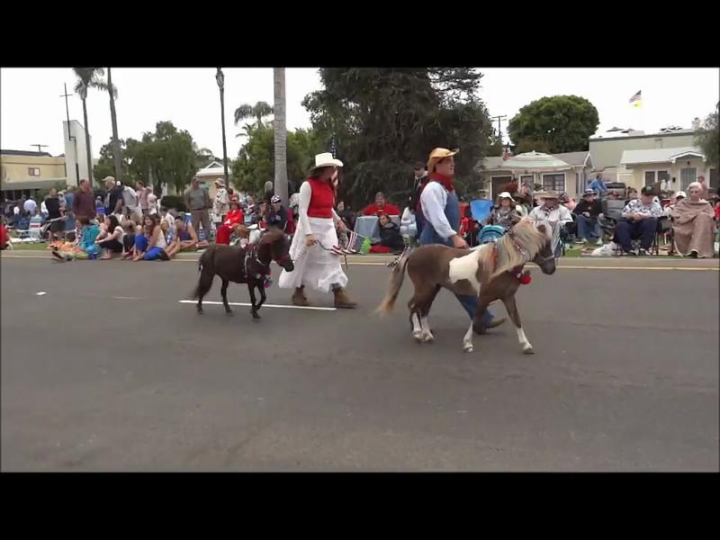 "Part 5 of 6: 2012 Coronado California 4th of July Parade (HiDef)<br /> <br /> All Coronado links at <a href=""http://crowncity.com"">http://crowncity.com</a><br /> This  video covers the following entries: <br /> <br /> The Prancing Pony San Diego<br /> Lamb's Players Theatre Coronado<br /> Coronado Democratic Club<br /> Antique Auto Club of America, San Diego<br /> Adrian Empire - Kingdom of Terre Nueve, San Diego<br /> USS Midway, San Diego<br /> Optimist Club of Coronado<br /> The Candyman, San Diego<br /> San Diego Knights of Columbus<br /> U.S. Navy Assault Craft Unit One Naval Base, Coronado<br /> Coronado Chamber of Commerce<br /> John P. Squibob Chapter of E Clampus Vitus, San Diego"