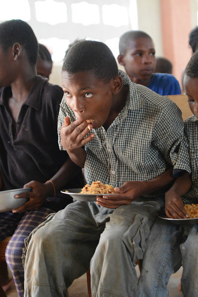 One of those that will eat this day. Each day they determine how many children they can feed and allow that number of children inside the church.  Each child brings their own bowl.  There are always children left outside because there is just not enough for everyone.