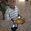 A dinner of rice and beans.  Each day they determine how many children they can feed and allow that number of children inside the church.  Each child brings their own bowl.  There are always children left outside because there is just not enough for everyone.