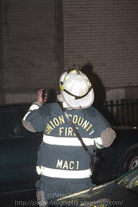 "Union County Mutual Aid Fire Coordinator (MAC-1) Elizabeth Deputy Chief Lathey Wirkus watches operations on the ""B"" side of the building."