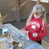 Tessa makes a corn husk doll at Peralta Adobe house in San Jose