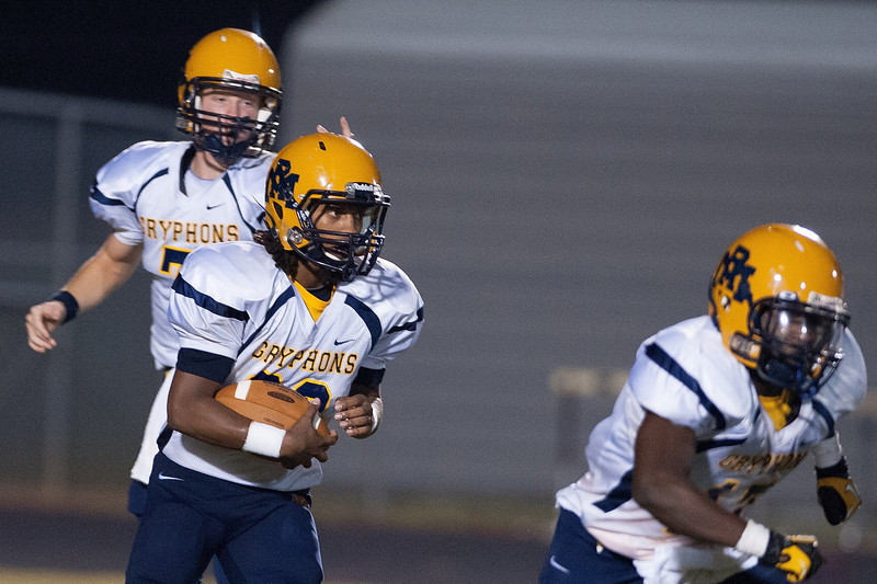 Rocky Mount  QB  hands the ball off during to nights game.Rocky Mount defeats Nash Central 13-6 in Nashville North Carolina.