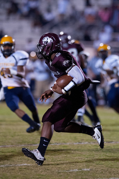 Nash Central QB Khalil Mackln carries the ball during tonights game.Rocky Mount defeats Nash Central 13-6 in Nashville North Carolina.