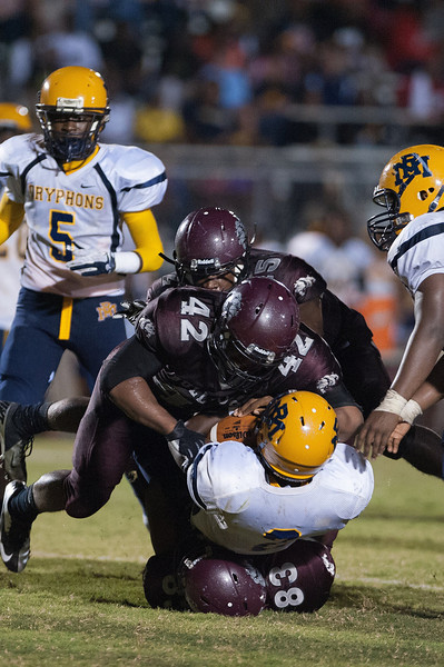 Rocky Mount Mason Hines #2 carries the ball until hit hard by Nash Central #42 during to nights game.Rocky Mount defeats Nash Central 13-6 in Nashville North Carolina.
