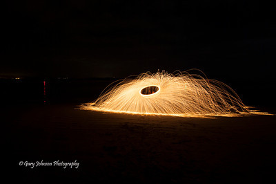Ben Willmore's light painting class.  Spinning the steel wool over his head.  Photographer's Name: Gary Johnson Photographer's City and State: Sonora, CA