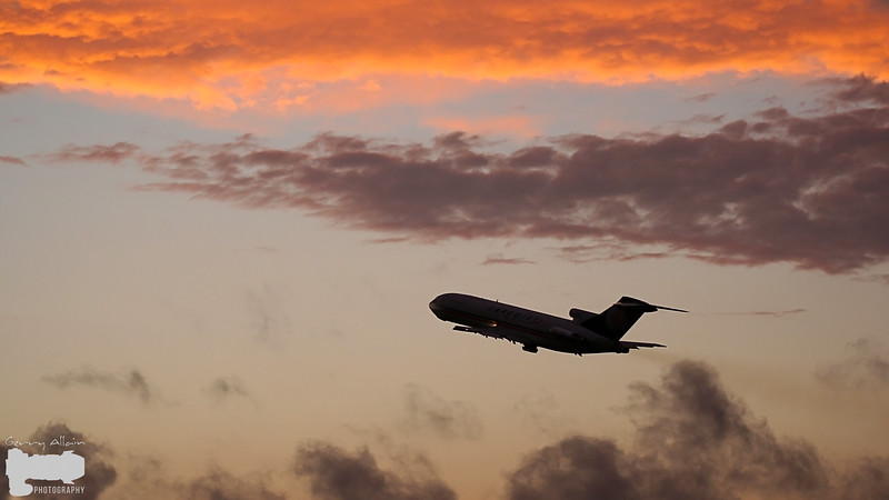 Cargojet (Boeing 727) lifting off runway 29 at Sunset after a rain storm