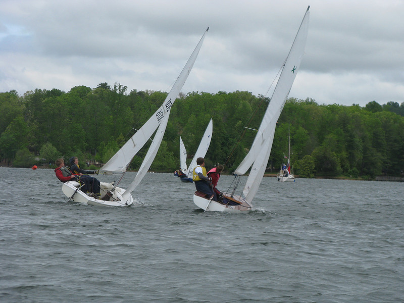 Parker (left) tries to keep his bow ahead of Hennon (right) as they head toward the line on Sunday.