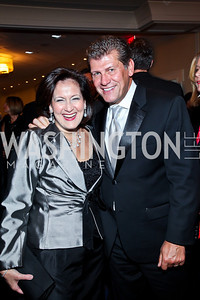 Anita McBride, Honoree Geno Auriemma. Photo by Tony Powell. 2012 NIAF Gala Awards Dinner. Hilton Hotel. October 13, 2012