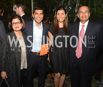 Farah Ispahani, Sajit Gandhi, Shamila Chaudhary, Hursan Haqqani, Ashley Bommer and Vikram Singh celebrate with friends at the home of Vali and Darya Nasr. Photo by Ben Droz.