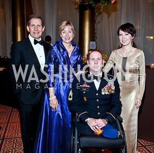 USO President Sloan Gibson and Margaret Gibson, SFC Aaron Causey and Kathleen Causey. Photo by Tony Powell. 2012 CharityWorks Dream Ball. Building Museum. September 29, 2012
