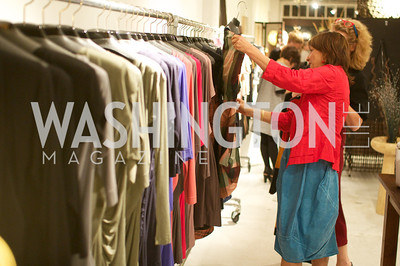 Nora Pouillon, Ami Aronson look at clothing. Environmental Working Group hosts an Earth Day reception, with Washington Life Magazine.