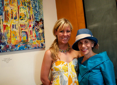 Maggie O'Neill, Susan Schneider. Evers & Co. Spring Art Show in Dupont.  Photo by Ben Droz.