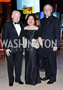 Philippines Amb. Jose Cuisia and Maria Cuisia, Father Phillip Brown. Photo by Tony Powell. The National Museum of Catholic Art & Library Board of Trustees Gala. Italian Embassy. September 26, 2012