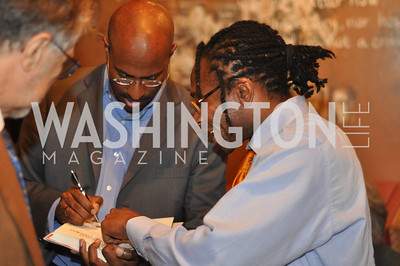 Van Jones  signs a book for Alain Temgoua .Van Jones speaks about his book Rebuild the Dream at Busboys and Poets