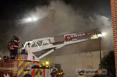 Tuesday, March 27, 2012 - Carlisle Borough, PA - Heavy smoke eminates from an apartment building fire on W. High Street in downtown Carlisle that went to three alarms and left several people homeless.