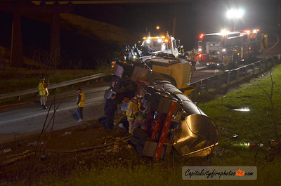 Friday, March 30, 2012 - Susquehanna Township, PA - A tanker truck lies overturned on the Route 322 westbound exit ramp from Interstate 81 northbound spilling chicken fat that required the response of area fire companies and Dauphin County Hazmat. The driver suffered minor injuries and the ramp was closed for several hours.