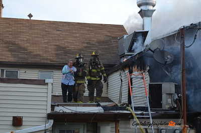 April 11, 2012, Hummelstown Borough, PA - Firefighters help rescue an occupant from a second floor apartment after a morning fire broke out in the rear of Palermo's restaurant in the 100 block of East Main Street. The occupant suffered smoke inhalation and the fire caused heavy damage to the building.