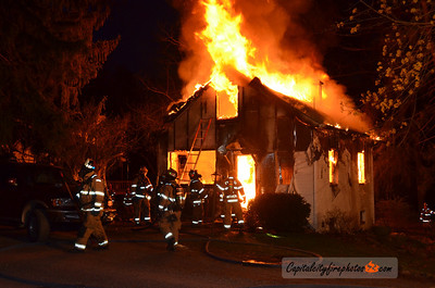 Wednesday, April 4, 2012 - Middle Paxton Township - Firefighters work to control a fire involving an occupied, single family, dwelling that broke out just before dawn in the 1100 block of Stoney Creek Road.