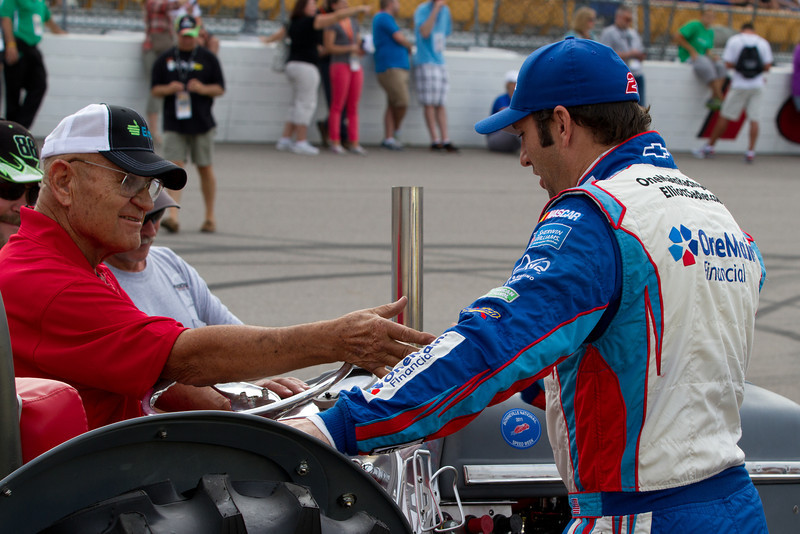 Day 217 - 4 August 2012<br /> Elliott Sadler discusses the Enlist drag racing tractor with the owner before the U.S. Celluar 250 at the Iowa Speedway