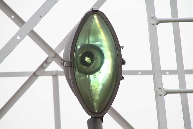 Day 32 - Here's Looking at You<br /> Well, maybe it should be who's lighting the way.  Have never seen a flood light shaped like this.  Shows tag, Revere Lighting.  Not really sure how old it really is.