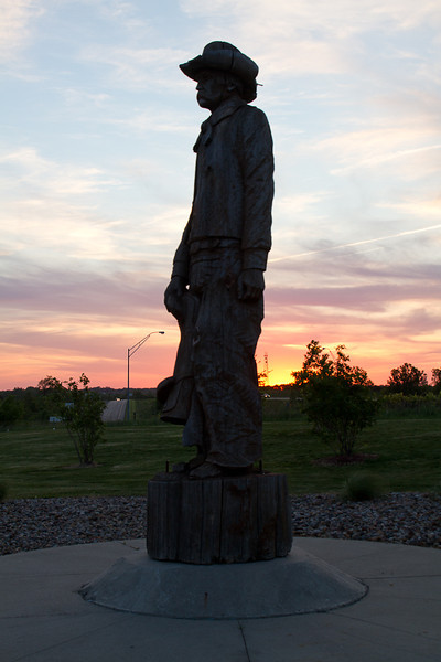 Day 138 - 17 May 2012<br /> Stopped for gas this evening on my way home.  Noticed this wood carving of a cowboy looking out across the prairie at sunset.