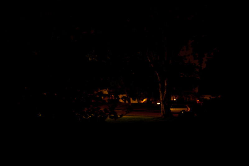 Day 234 - 20 August 2012<br /> Ever wonder how dark is dark - our streetlight is out this only the lights from my neighbor's garage.