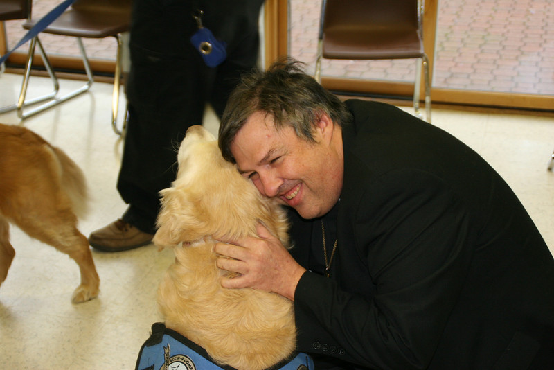LCMS New England District President Rev. Timothy Yeadon with K-9 Comfort Dog Barnabas at Christ the King Lutheran Church, Newtown, Connecticut.