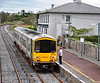 The driver of the 1355 Limerick Jct - Waterford is handed the Electric Train Staff for the Tipperary - Clonmel Section. Sat 07.04.12