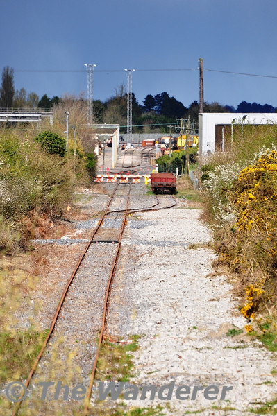 "The track panels which were stored on the former line to Kilkenny two years ago have been removed (see: <a href=""http://smu.gs/HmmAwZ"">http://smu.gs/HmmAwZ</a>). The stub of the Kilkenny Line is used as a headshunt for the Per-Way yard in Portlaoise. There is a trailing connection off the siding which was part of a grander plan to serve the Avonmore Grain Factory. The former Barytes Wagons are currently stored on this siding awaiting scrapping. In the backround 084 is stabled between duties.Tues 03.04.12"