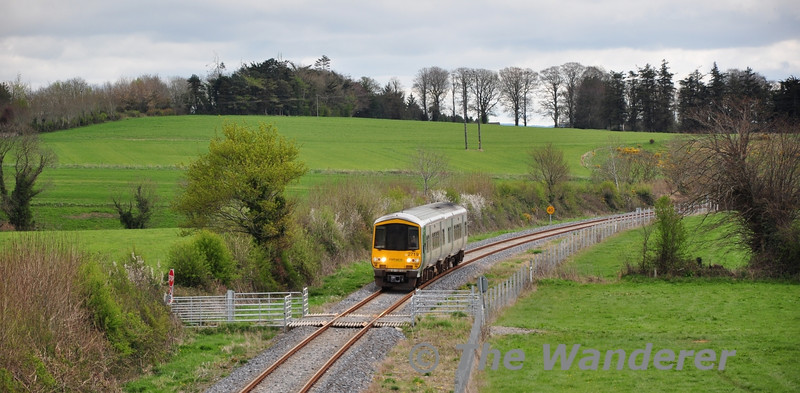 2719 + 2722 approach an accommodation level crossing near Ballynaraha with the 1140 Waterford - Limerick Jct. Sat 07.04.12