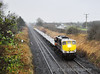 072 brought a train of Per-Way wagons as a 1210 Limerick - Portlaoise Per-Way Yard on Tuesday 4th December 2012.  It consisted of 11 flat wagons used for carrying track panels plus a single spoil wagon. In the middle of a winter downpour the train passes Clonkeen, just south of Portlaoise.